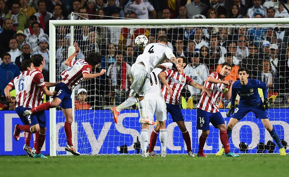 LISBON, PORTUGAL - MAY 24: Sergio Ramos of Real Madrid (4) scores their first goal with a header during the UEFA Champions League Final between Real Madrid and Atletico de Madrid at Estadio da Luz on May 24, 2014 in Lisbon, Portugal. (Photo by Laurence Griffiths/Getty Images)