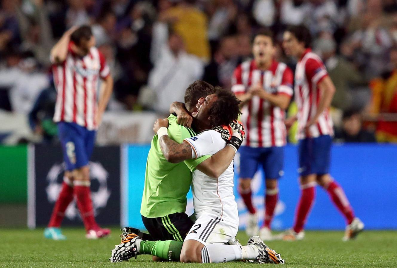 JSG. Lisbon (Portugal), 24/05/2014.- Real Madrid's goalkeeper Iker Casillas (L) and Marcelo Vieira celebrate the 1-1 goal during the UEFA Champions League final between Real Madrid and Atletico Madrid at Luz Stadium in Lisbon, Portugal, 24 May 2014. (Lisboa, Liga de Campeones) EFE/EPA/MARIO CRUZ